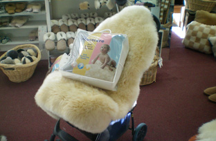 Lambskin Infant Care Baby Rug Draped Over Baby Stroller   One Of The Best Sheepskin  Baby